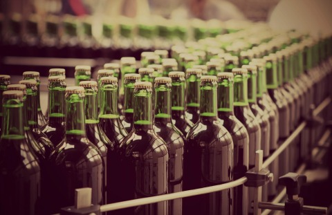 bottles on a production line, representing the Pay4 customer